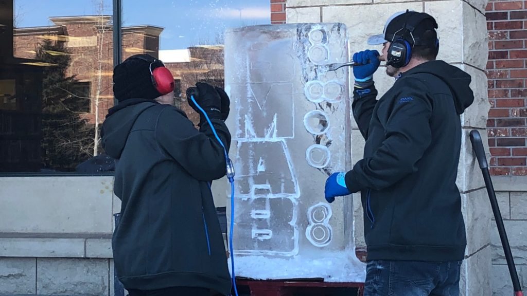 Ice sculptors carve braille designs for Bozeman chapter of